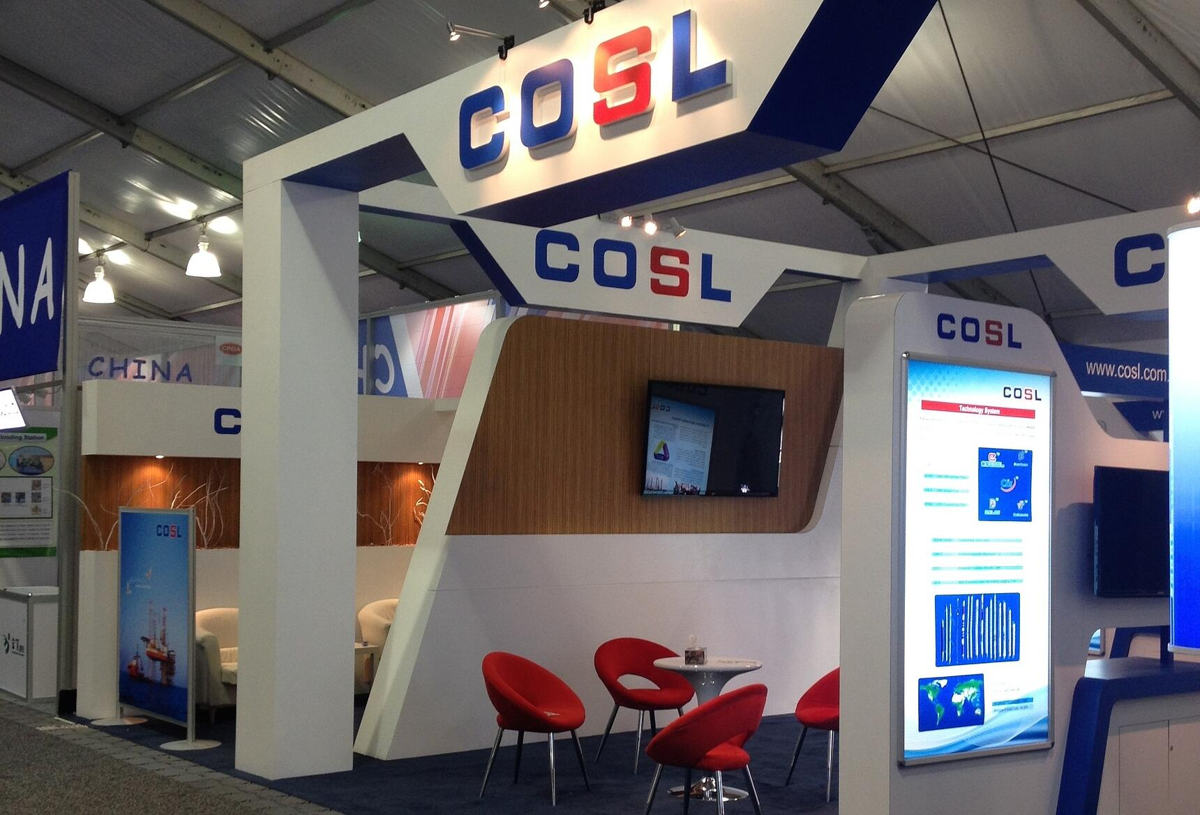 COSL custom exhibit with curved counters, lightboxes and 3D lettering.