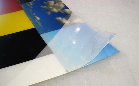 Delamination: the laminate pulling away from the printed graphic.