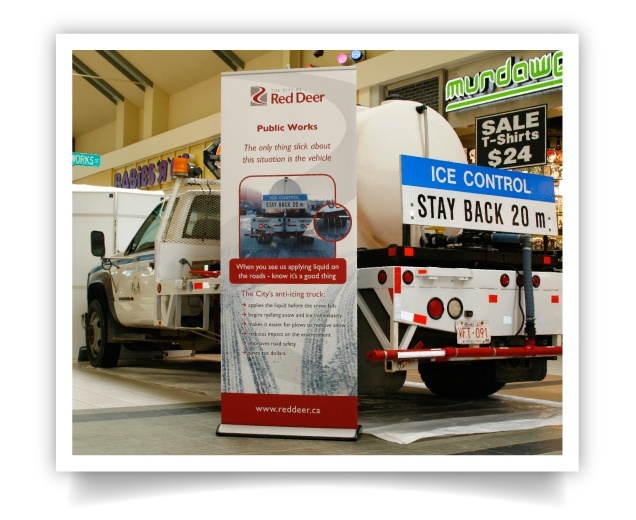A banner stand paired with a display at a local mall.