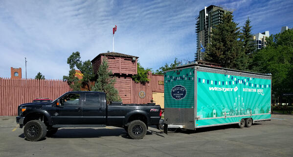 WestJet's Stampede game being pulled by a truck to the site where it will be set up.