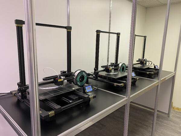 Three 3D printers working tirelessly